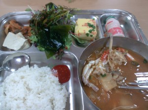 Crab soup, tofu, kimch, veggie custard, and greens