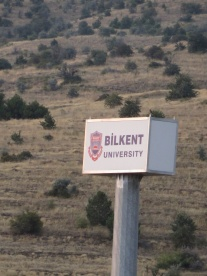 "Campus sign in ""the wilderness"""